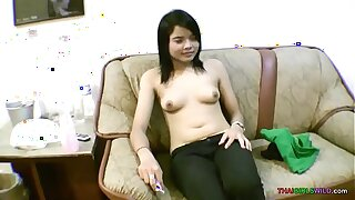 Baby face Asian teenage spreads hairless muff for foreign cock
