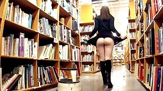 Uber-cute brunette exhibitionist flashing at the bookstore